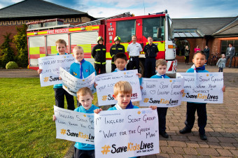 Members of the 1st Ingleby Barwick Scout Group proudly display their road safety posters following a visit from Cleveland Fire Brigade