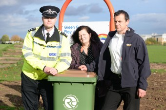 Redcar & Cleveland Council, Cleveland Police and Cleveland Fire Brigade join together to warn people to put their wheelie bins away in the run up to mischief night. Pictured at Green Gates Play Area (l-r) Chief Inspector Mark Hall, Councillor Helen McLuckie,  and Watch Manager Martin Hall.