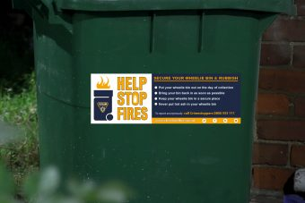 wheelie bin with help to stop fires sticker