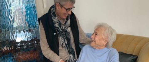 volunteer smiling down at befriending service user