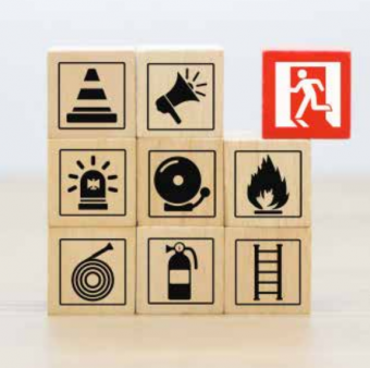 wooden blocks with different fire safety images with fire exit highlighted