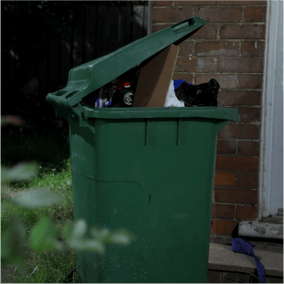 overflowing wheelie bin outside property