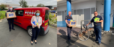cfb staff handing over road safety equipment to NHS staff