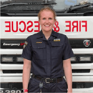 niki taylor on call fire fighter stood infront of a fire engine